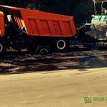 Фотофакт: «Камаз» новгородских дорожников застрял в свежем асфальте на Парковой