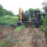 Фотофакт: дорогу, которую размыло ночью в Боровичском районе, оперативно восстановили